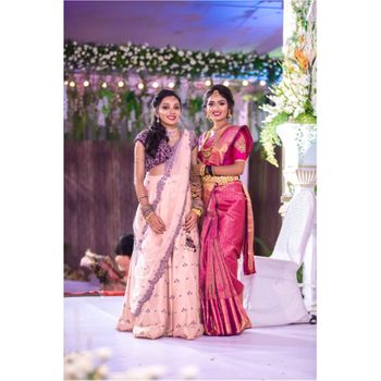 A south Indian bride in a pink kanjeevaram with her friend