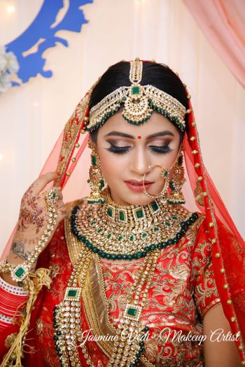 A bride in red and heavy jewellery