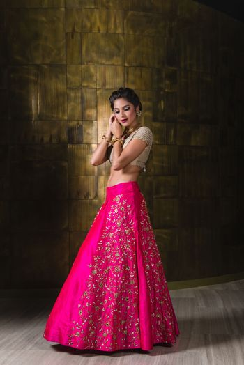 Photo of fuschia raw silk lehenga