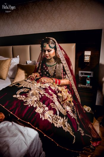 Bridal lehenga in velvet with big motifs