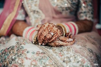 Bridal hands on wedding with engagement ring