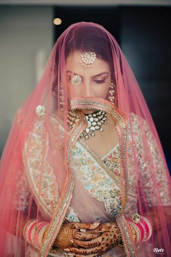 Wedding day bridal portrait idea with dupatta as veil