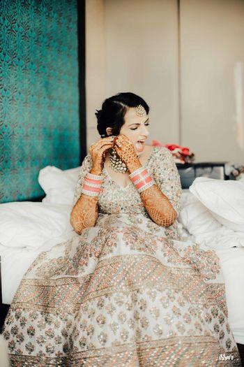 Crazy bridal portrait wearing earrings