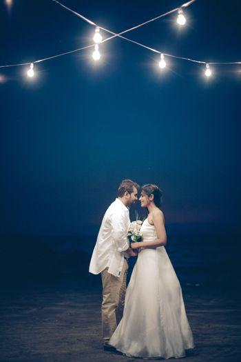 Cute couple portrait with fairy lights