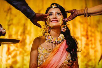 Haldi bridal portrait with floral jewellery