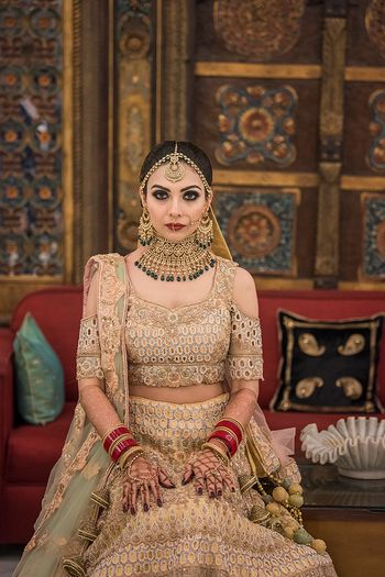Beige lehenga cold shoulder blouse