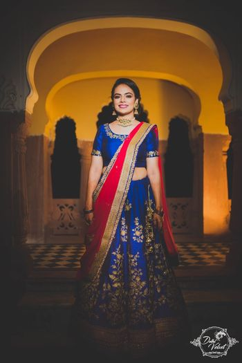 Royal blue and red lehenga for sangeet