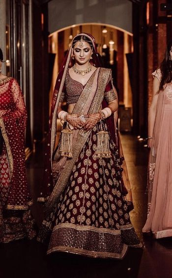 Photo of Pretty gold and maroon bridal lehenga for wedding