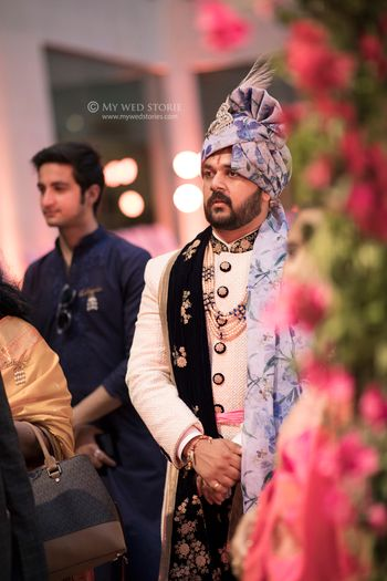 Groomwear trends with blue floral safa