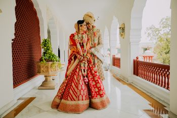 Photo of A bride and groom with pretty jaimala