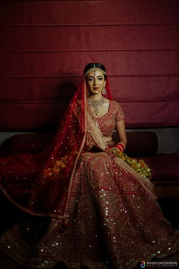 Dark bridal portrait in red lehenga