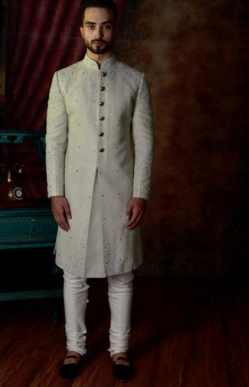 Classic ivory sherwani for grooms.
