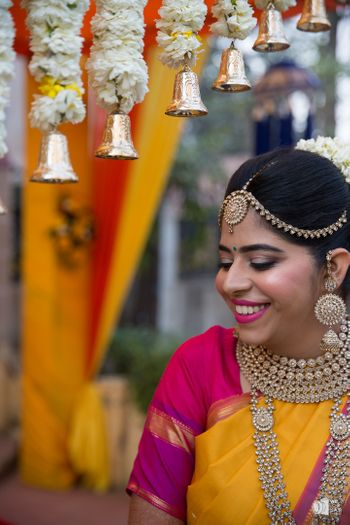 Stunning south Indian bridal shot with hanging bells decor