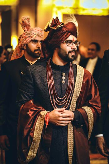 Offbeat groom sherwani in black and maroon