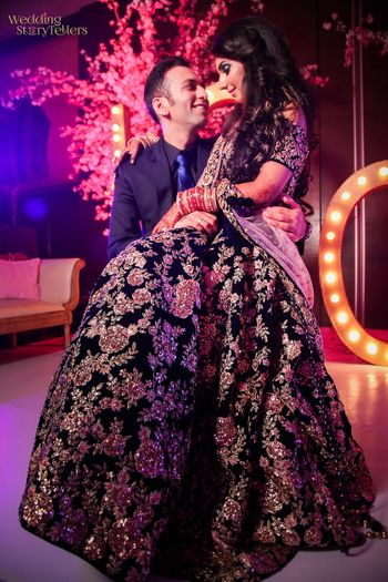 Sangeet couple portrait with embellished gown
