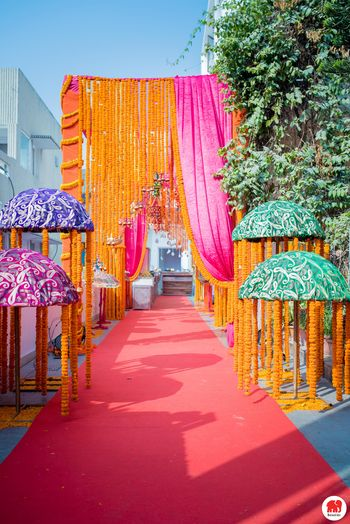 Floral curtains and umbrella decor for mehendi