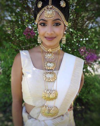 Bride wearing unique necklace