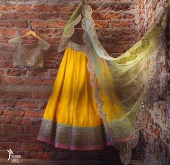 Photo of yellow ad blue and pink lehenga