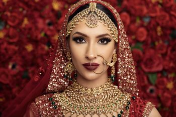Photo of A bride in red lehenga and heavy jewellery