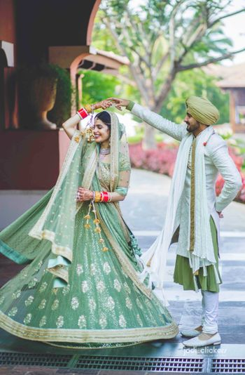 Photo of Couple dancing portrait in offbeat colour outfits