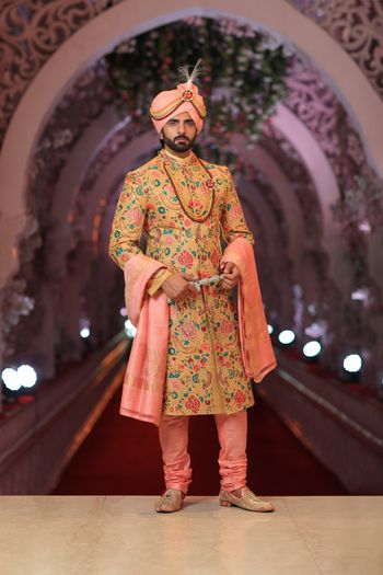 Pretty peach and cream sherwani for wedding