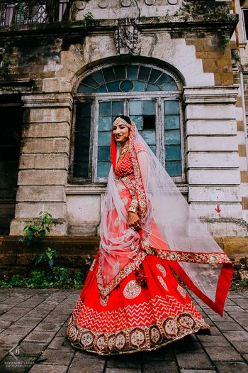 Bridal portrait in red and maroon lehenga