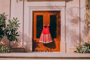 Red lehenga on hanger on the door