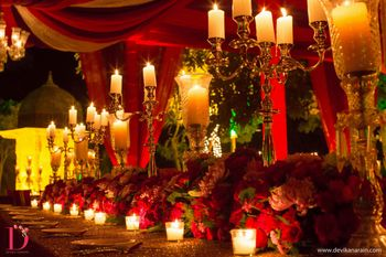 Photo of red and gold table settings