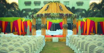 Yellow Mandap with Red and Yellow Tents