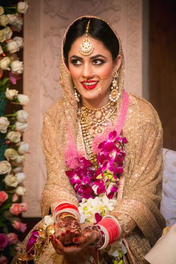 Champagne Pink Bride wearing Gold Bridal Jewelry