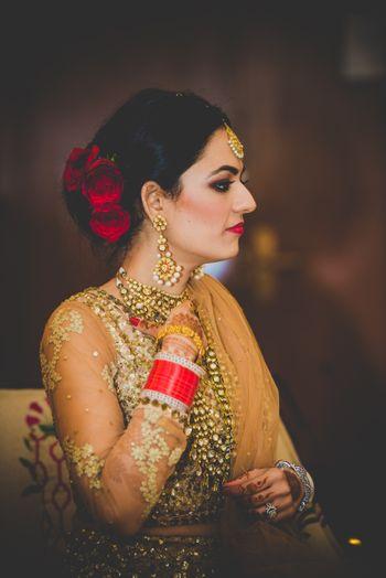 Bride Wearing Red Flowers on Hair