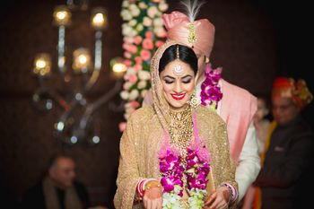 Photo of Bride Wearing Var Mala Shot