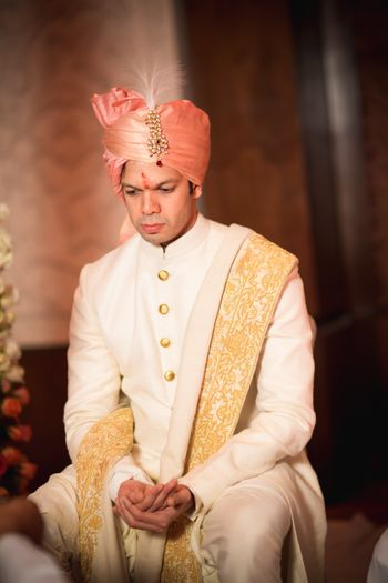 Photo of Off White and Gold Sherwani with Pink Safa