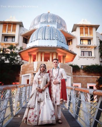 Bride in white lehenga with twinning groom