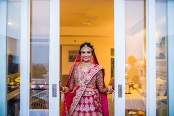 Red bridal lehenga with blue embroidery