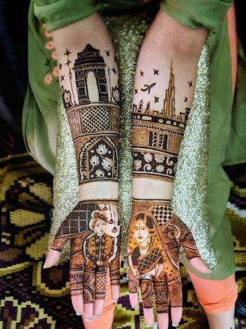 Photo of Personalised bridal mehendi idea with portraits