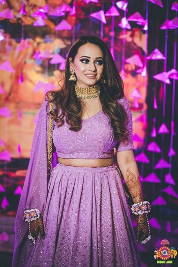 Lilac lehenga for mehendi with matching floral jewellery