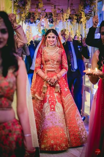 Photo of Unique red and pink patchwork lehenga