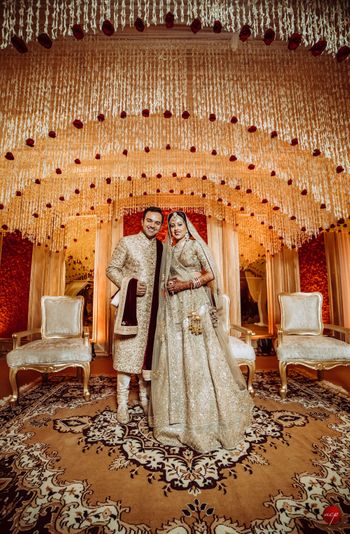 Grand wedding decor with bride and groom in gold