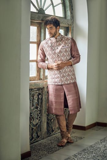 Offbeat colour Nehru jacket for groom on mehendi