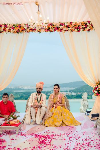 Photo of Couple portrait with bride in yellow lehenga