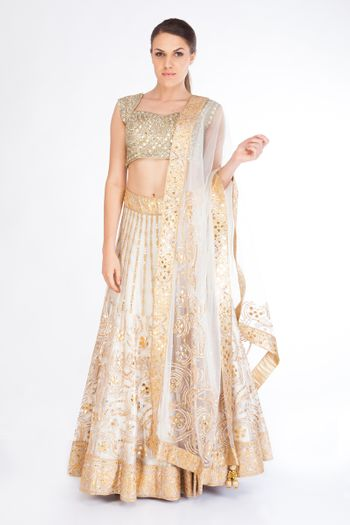 Photo of white and gold lehenga
