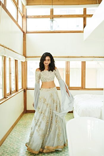Photo of Light lehenga in grey with unique sleeves