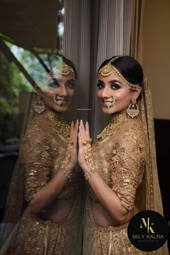 Nude subtle bridal makeup with beige lehenga