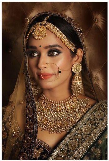 Bridal jewellery and makeup with dark lehenga