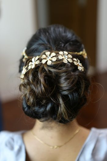 Messy Wavy Bun with Hair Accessory