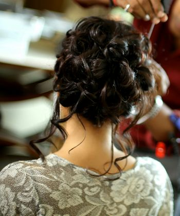 Photo of Engagement hairstyle bun with loose curls