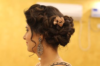 Braided bun with gold cloth roses