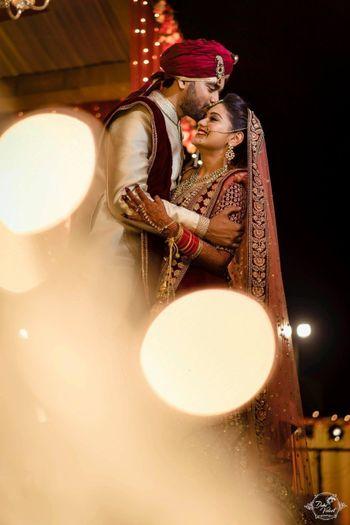 Couple portrait groom kissing bride shot