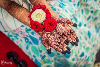Photo of Bride and groom real portrait on mehendi